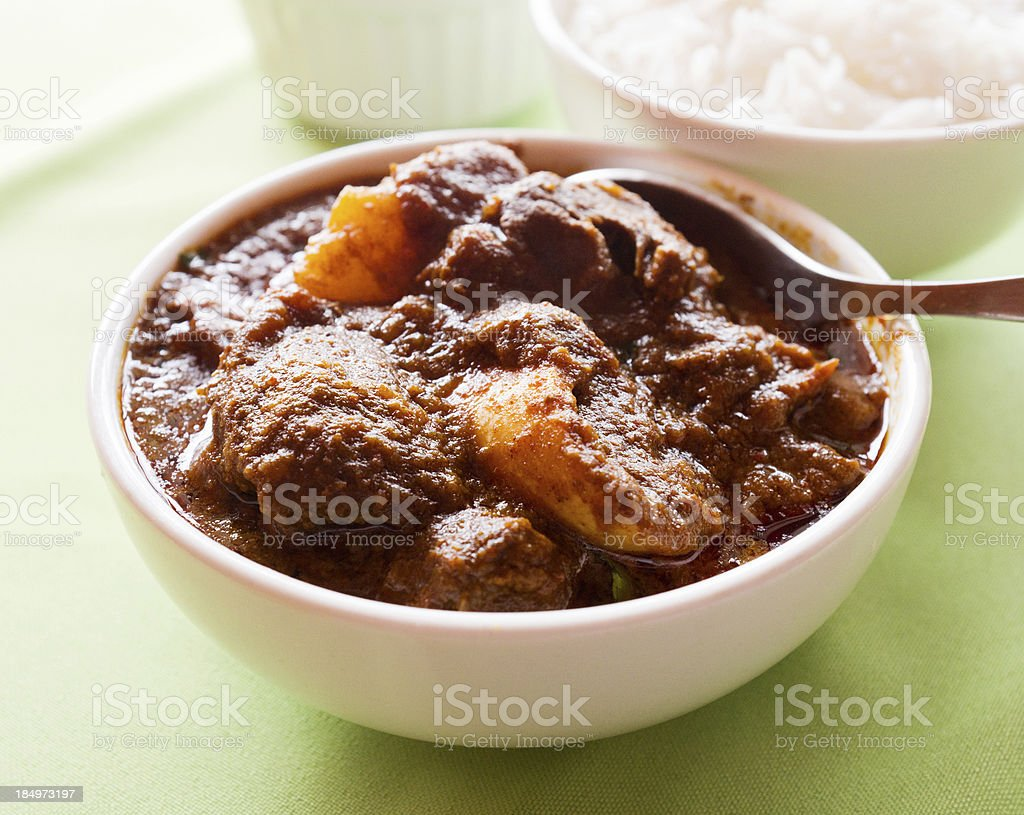 Lamb curry with potatoes and basmati rice stock photo