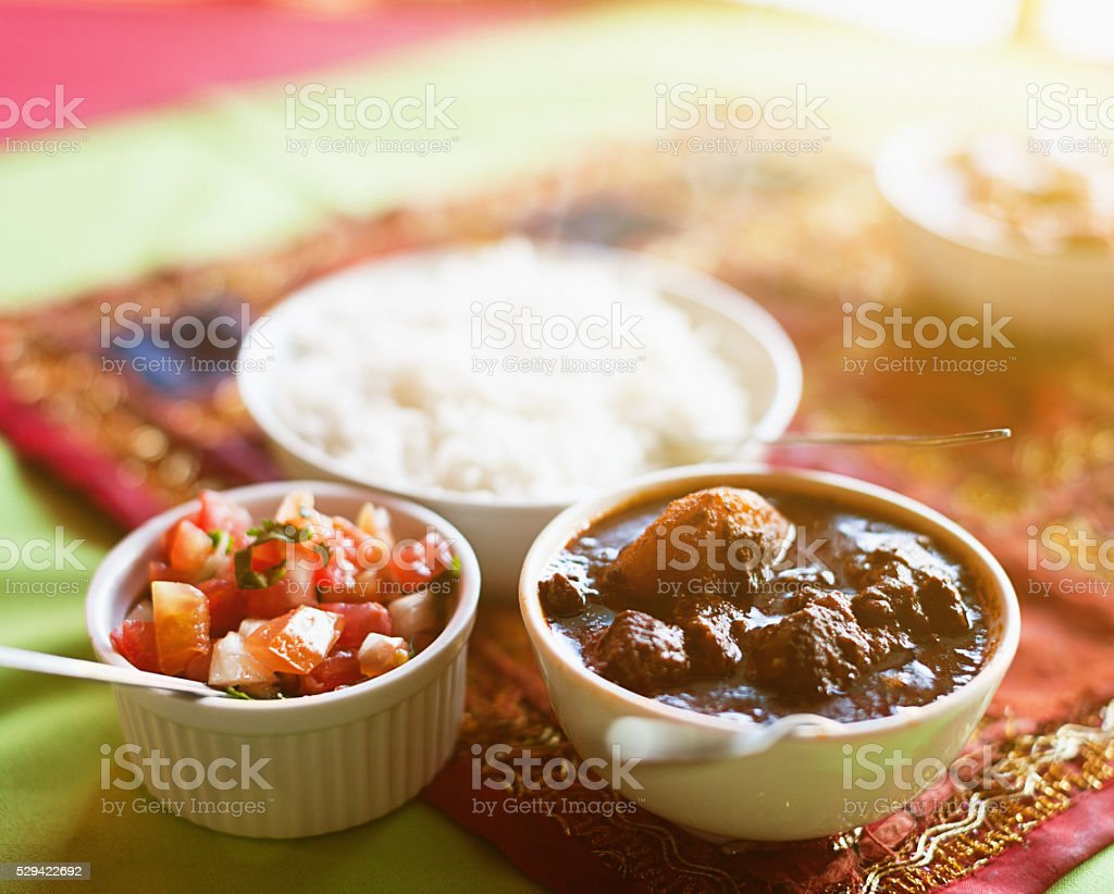 Lamb curry with sambals and rice looking appetizing stock photo