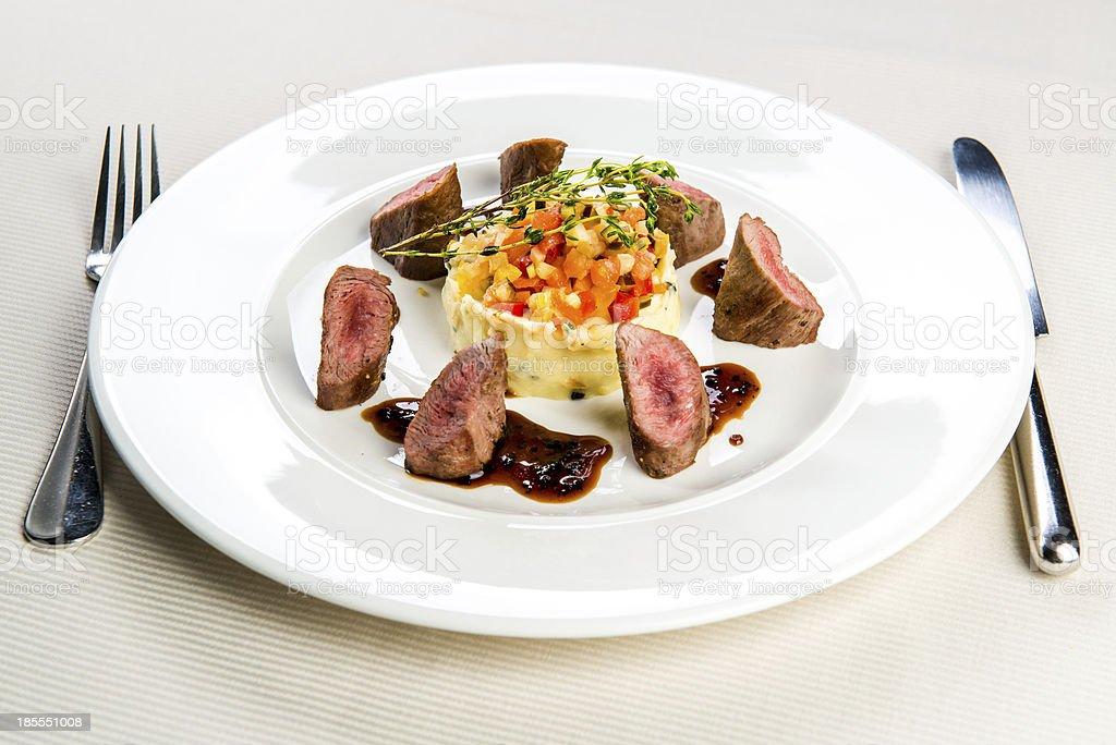 Lamb fillet and garnish royalty-free stock photo