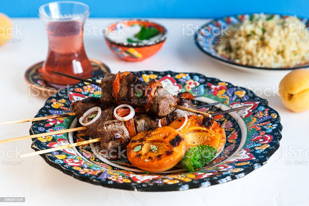 Lamb kebab with dried apricot, bulgur and rose tea royalty-free stock photo