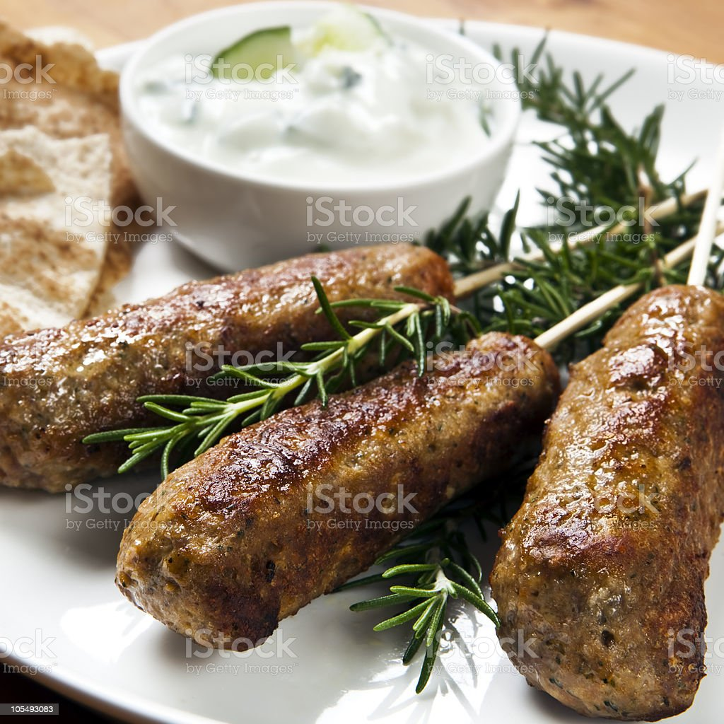 Lamb kofta skewers with yoghurt and rosemary royalty-free stock photo
