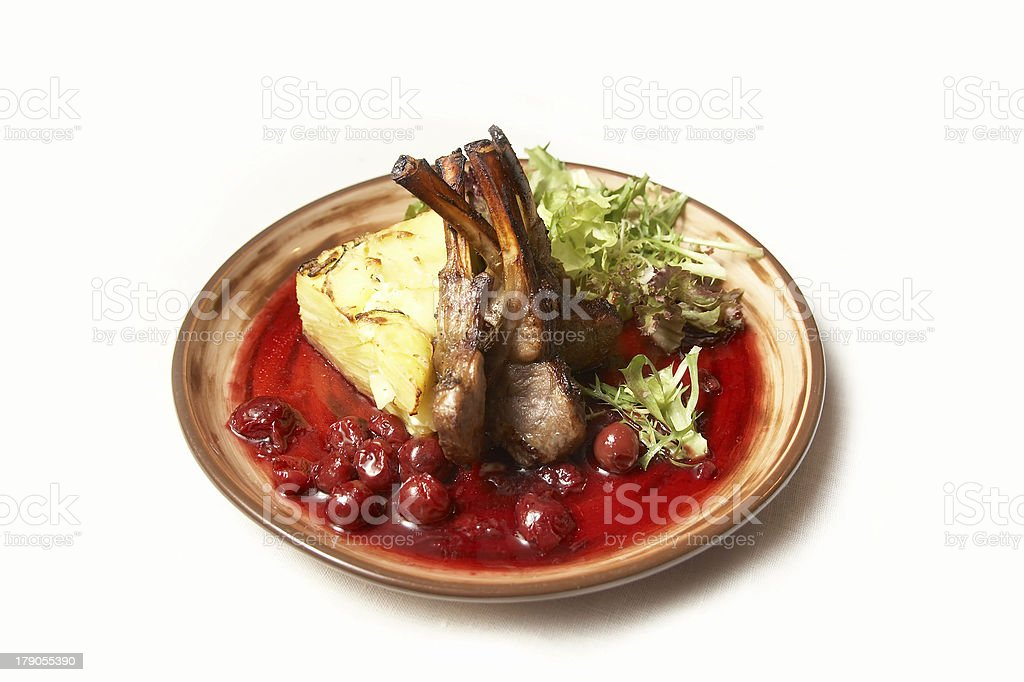 Lamb ribs with potato and salad leaves. royalty-free stock photo