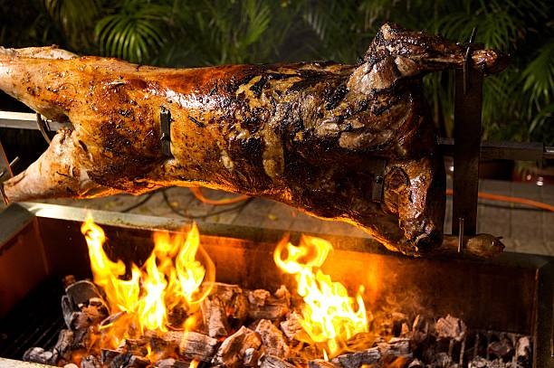 Lamb Roast on a Spit  spit roasted stock pictures, royalty-free photos & images