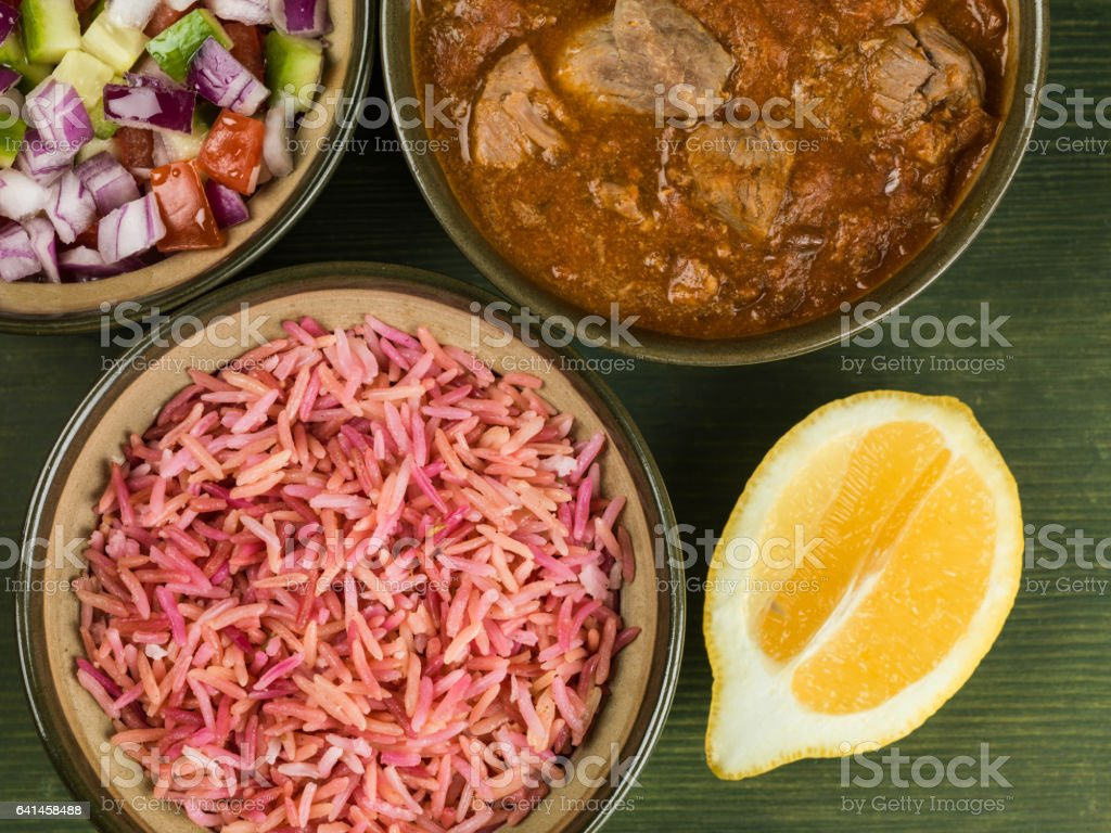 Lamb Rogan Josh Curry With Pilau Rice and Mixed Salad stock photo