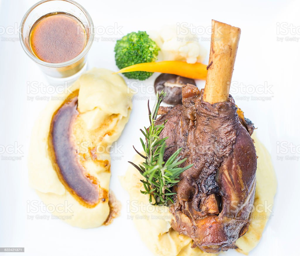 lamb shank and red wine stock photo