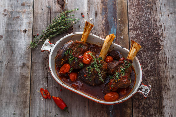 Lamb shank braised in tomato sauce, top view stock photo