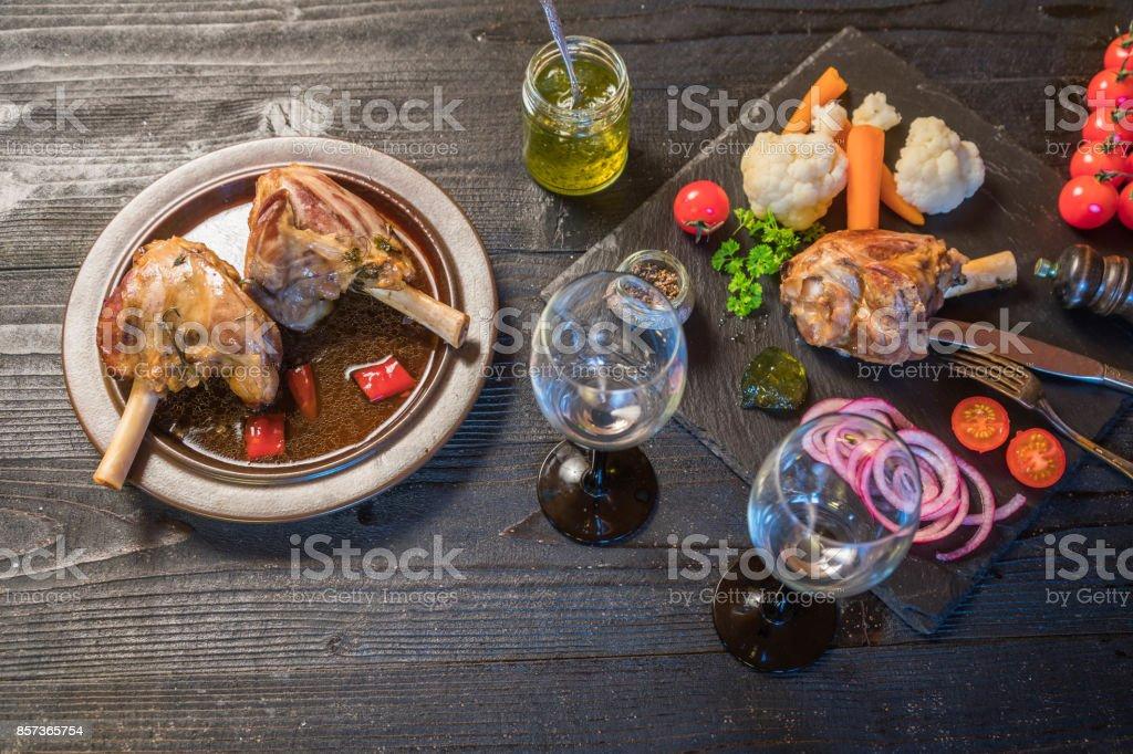 Lamb shank dinner stock photo