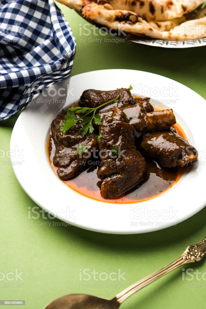lamb shank or mutton or gosht paya or khoor curry served with indian bread or roti or naan stock photo