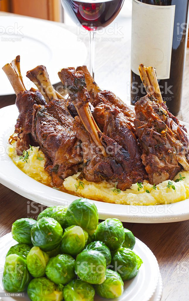 Lamb shank with Brussels sprouts royalty-free stock photo