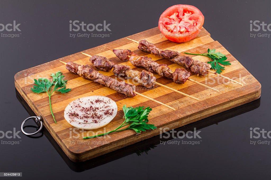 Lamb Skewers on Wood Plate stock photo