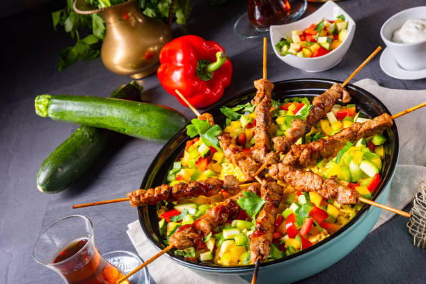 Lamb skewers with curry rice and different vegetables – zdjęcie