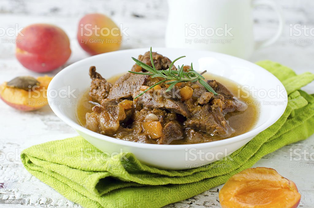 Lamb stew with apricots stock photo