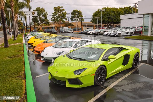 133277230 istock photo Lamborghini cars parked at the factory authorized dealership in California 973508178