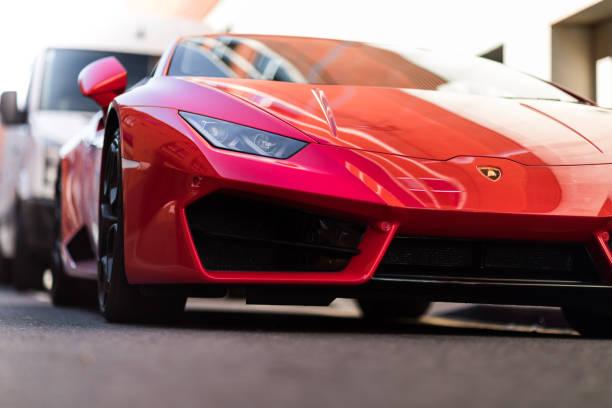 Lamborghini huracan Leicester, United Kingdom - March 25, 2017: Red Lamborghini Huracan sport car on street. ferrari stock pictures, royalty-free photos & images