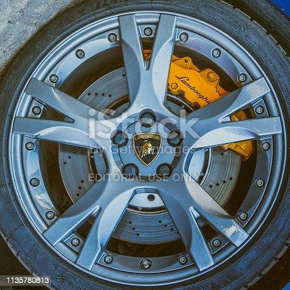 istock Lamborghini wheel with tyre, brake disc with yellow brake caliper and logo 1135780813