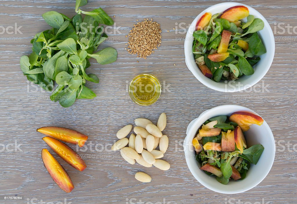 Lamb's lettuce salad in white dishes and its ingredients stock photo