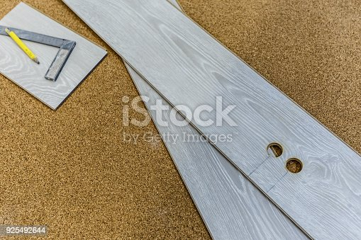 922081754 istock photo Laminate boards prepared for laying on the floor in the room closeup 925492644