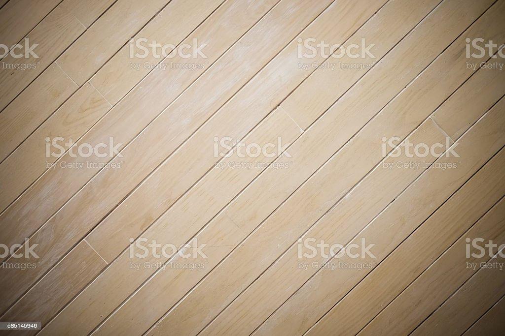 Laminate wood wall texture background, center spotlight, darken edge stock photo