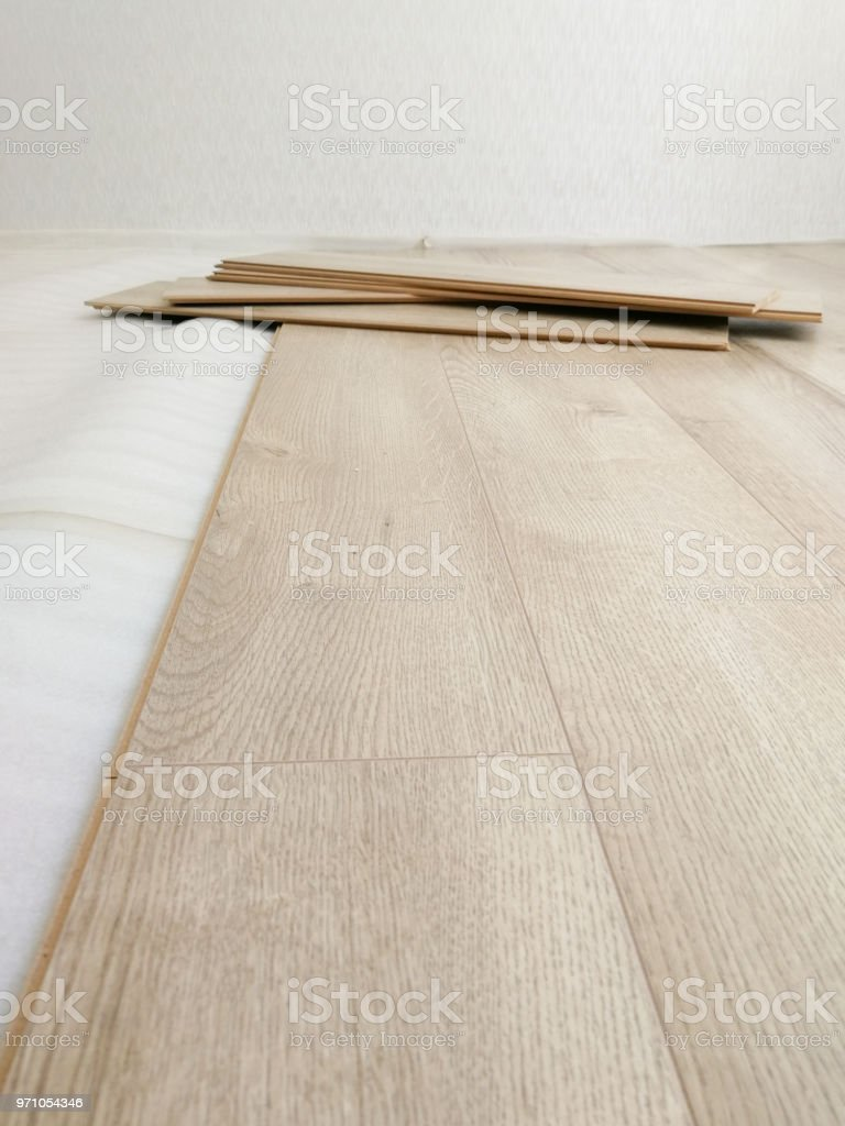 Laminated flooring under construction process. Home renewal concept stock photo