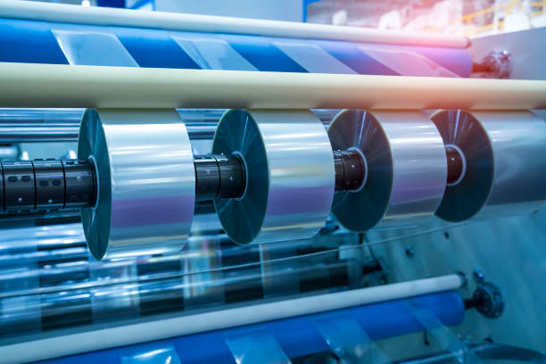 Laminating and rewinding kind of protective film machine with clamping rollers automatic edge banding stock photo