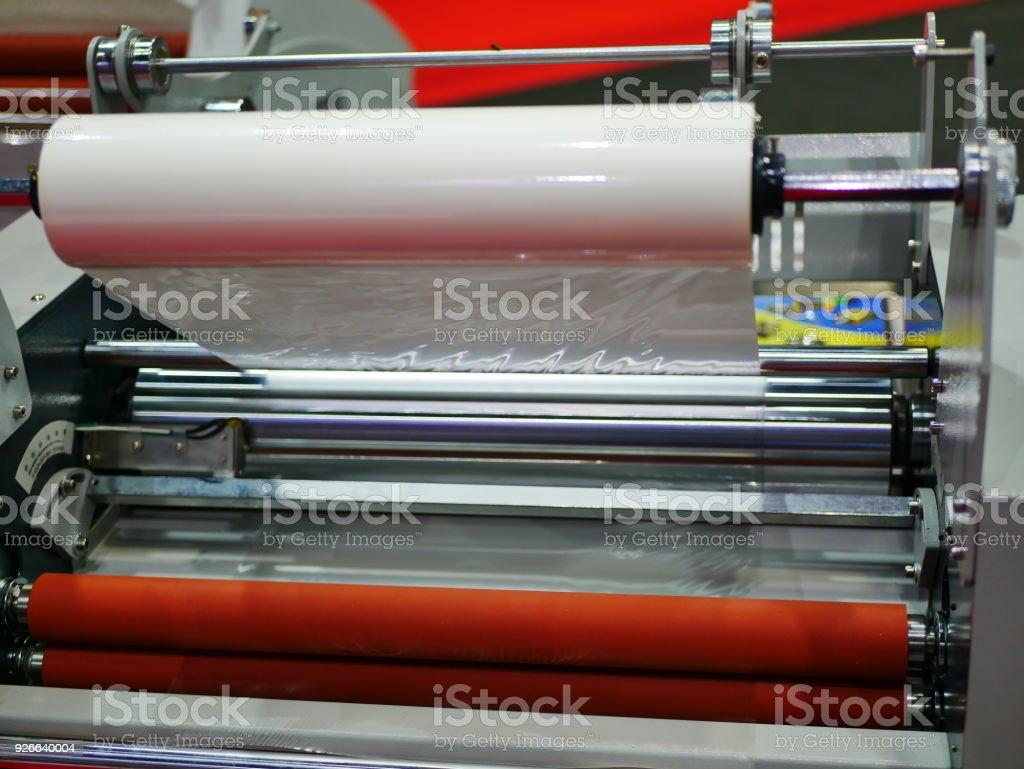 Laminating machine stock photo