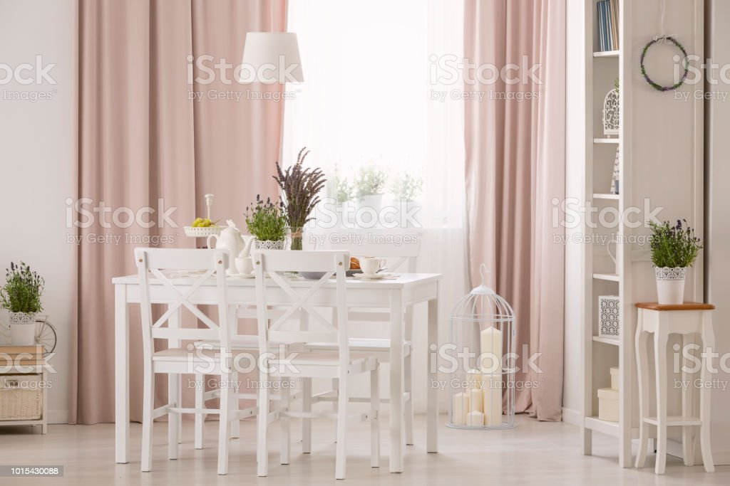 Picture of: Lamp Above Table And White Chairs In Pink Dining Room Interior With Plants And Drapes Real Photo Stock Photo Download Image Now Istock