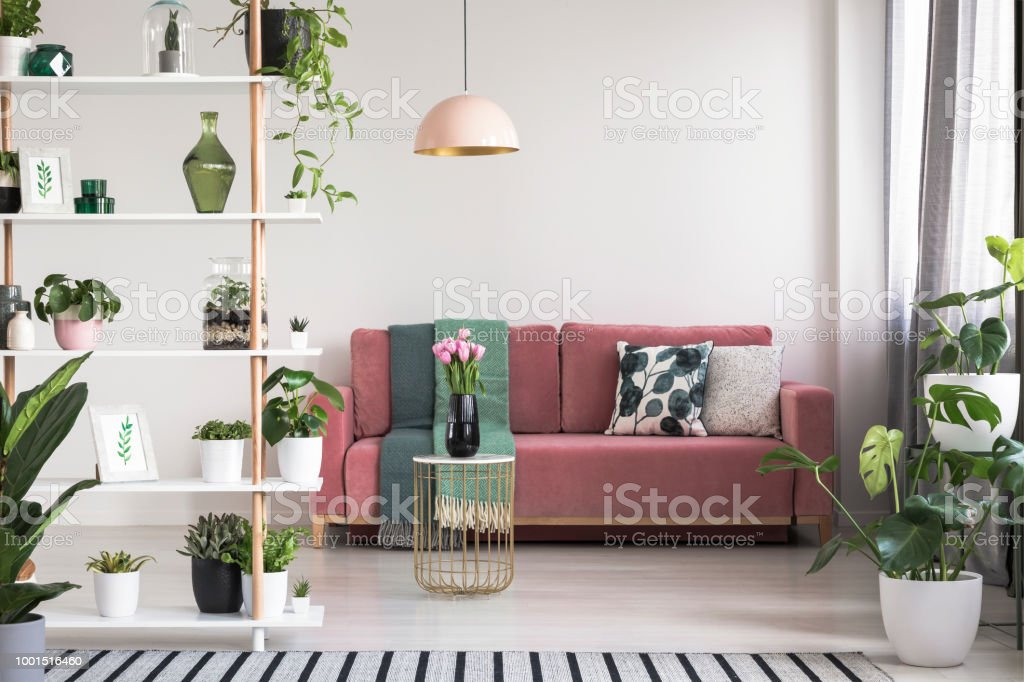 Wondrous Lamp Above Table With Flowers In Front Of Red Sofa In White Gmtry Best Dining Table And Chair Ideas Images Gmtryco