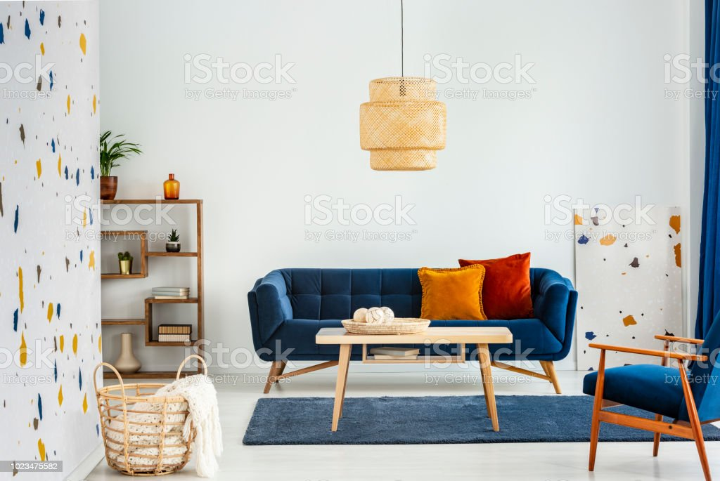 Lamp Above Wooden Table In Colorful Living Room Interior With ...