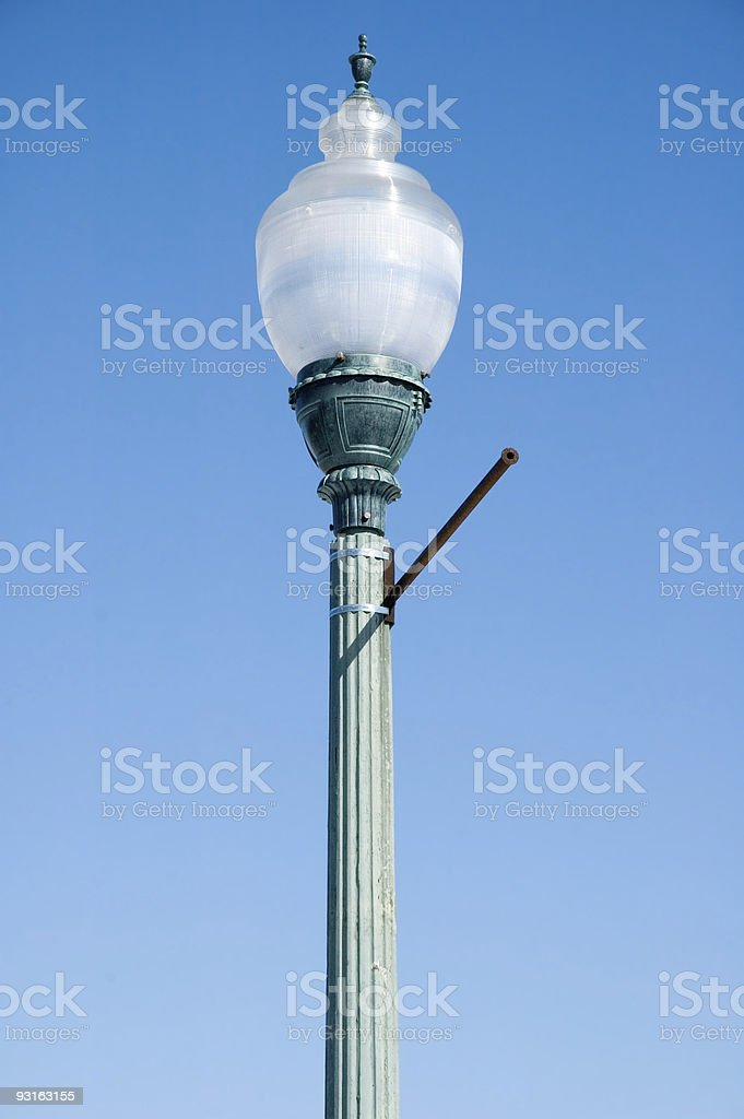 Lamp Against Bright Blue Sky stock photo