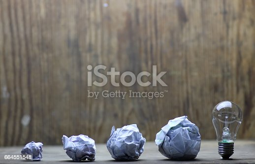 istock lamp and crumpled paper 664551548