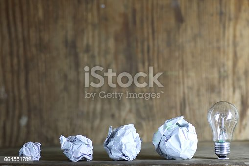 istock lamp and crumpled paper 664551782