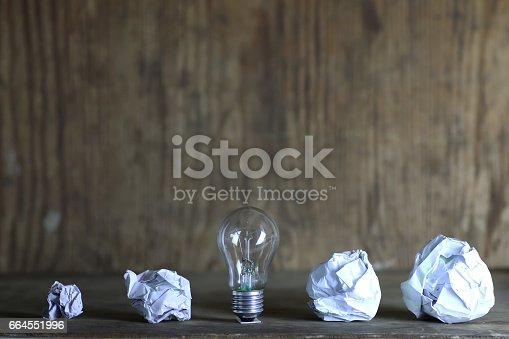 istock lamp and crumpled paper 664551996