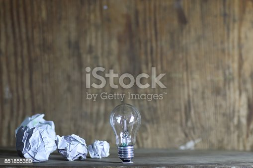 istock lamp and crumpled paper 851855380