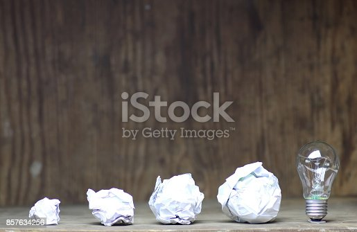 istock lamp and crumpled paper 857634256