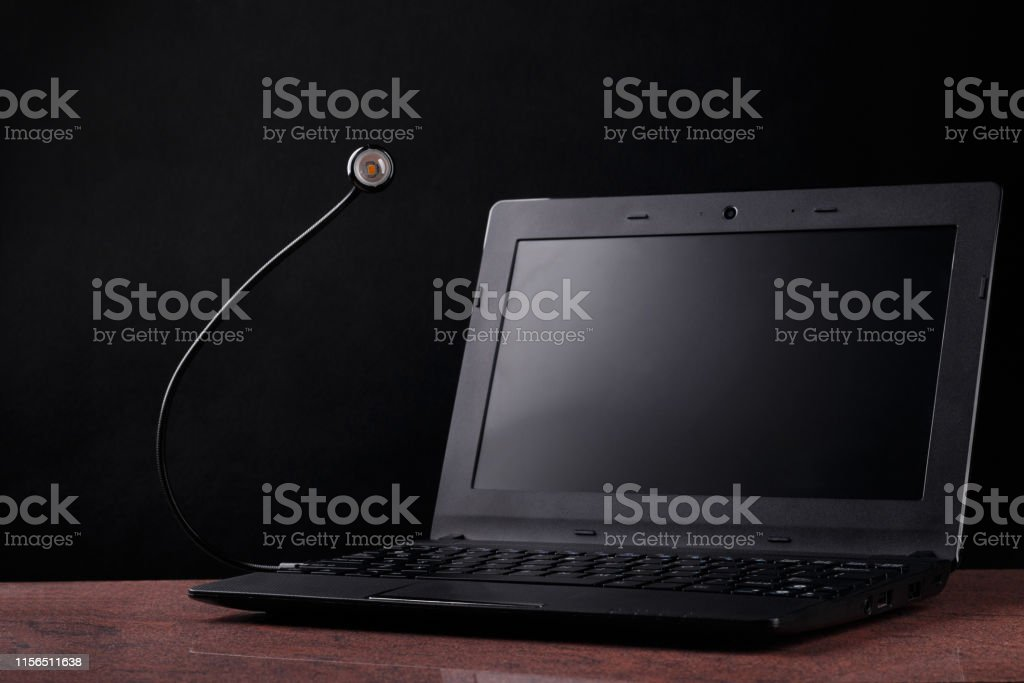Led Usb Lamp Connected To Laptop On Black Background Concept