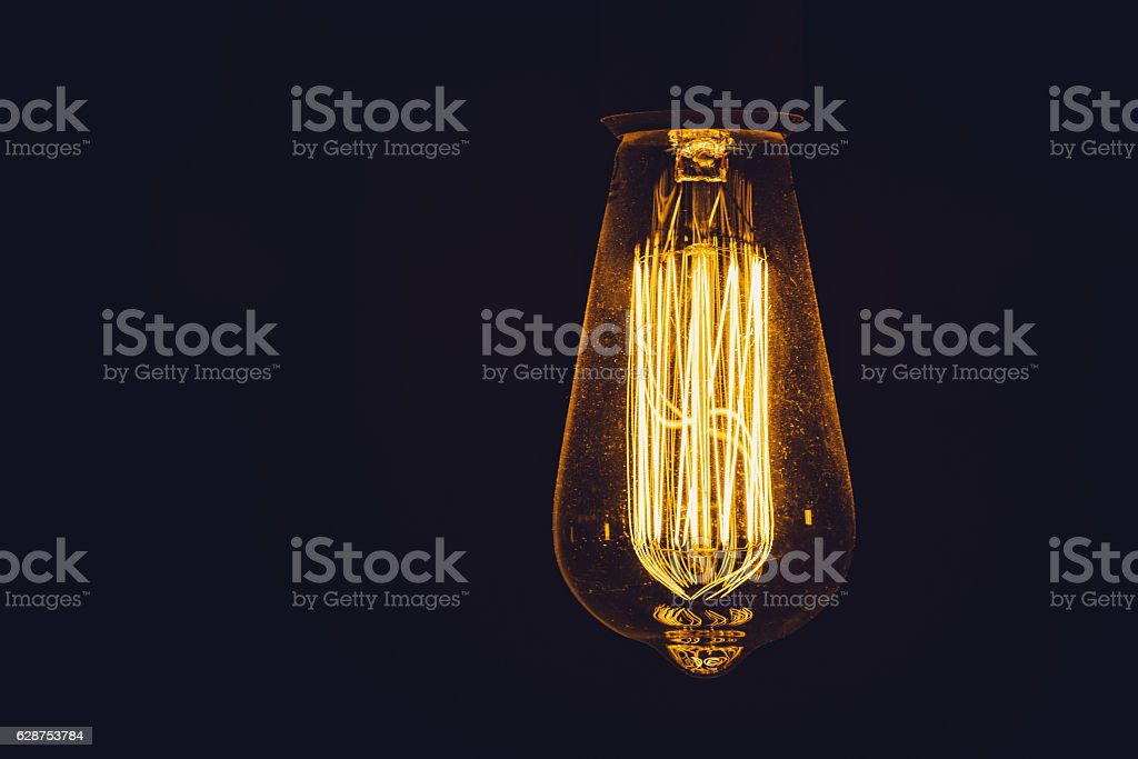 lamp filament on a black background stock photo