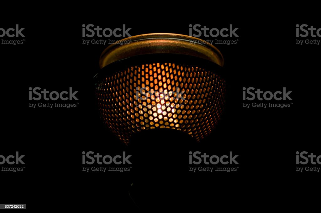 Lamp in a mesh cartridge on black background stock photo