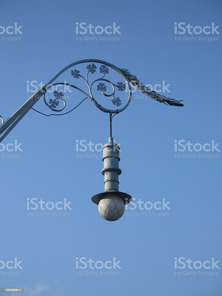 Lamp in blue sky royalty-free stock photo