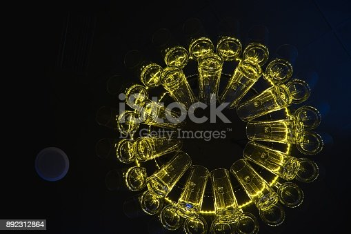 istock Lamp made of beer cups. 892312864