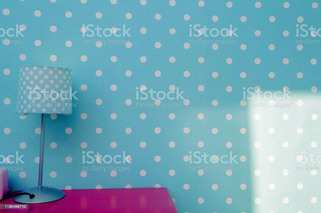 Lamp night light with blue wall and white dots wallpaper, colorful...