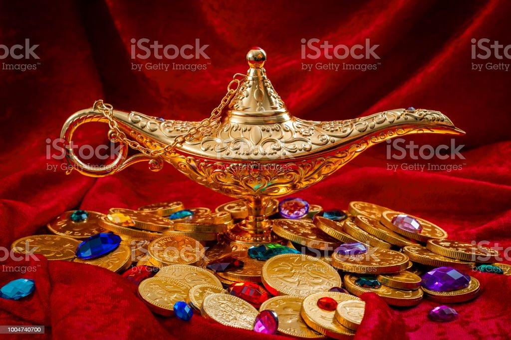 Lamp of Aladdin is a treasure chest charpetet in velvet stock photo