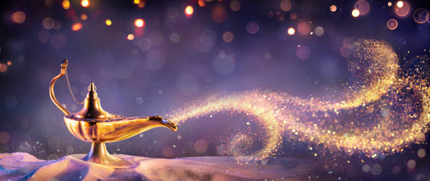 Lamp of Wishes On Sand In Desert - Genie Coming Out Of The Bottle stock photo