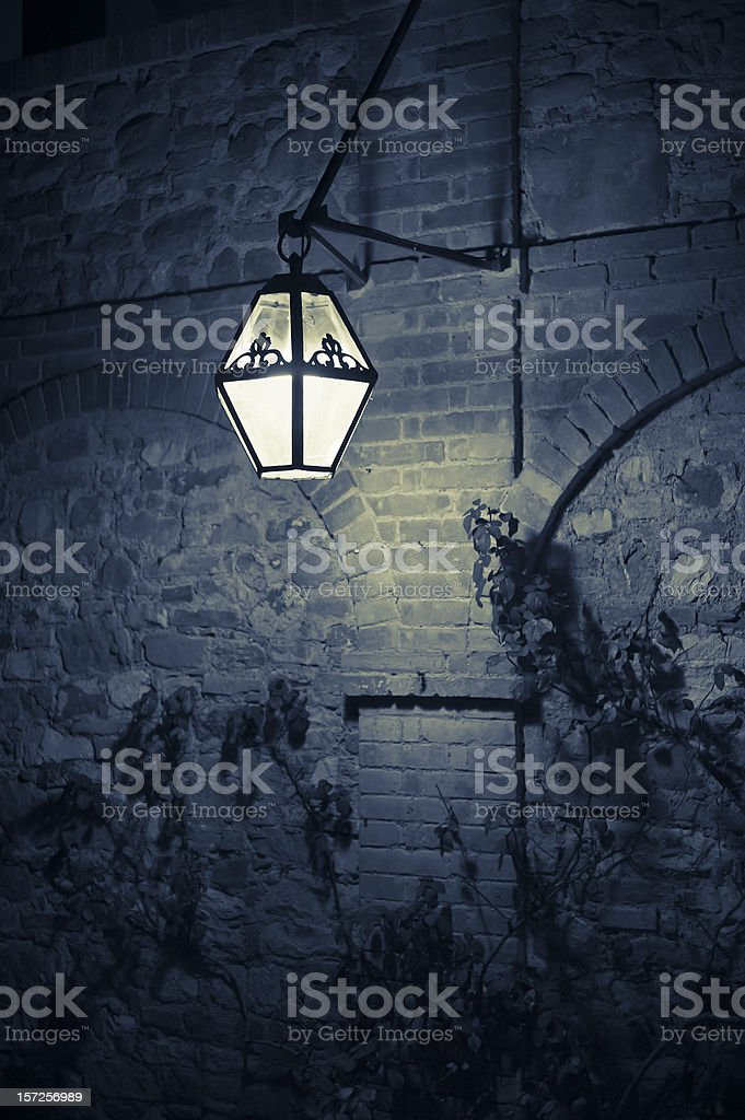 Lamp On A Rustic Wall In The Night, Tuscany royalty-free stock photo