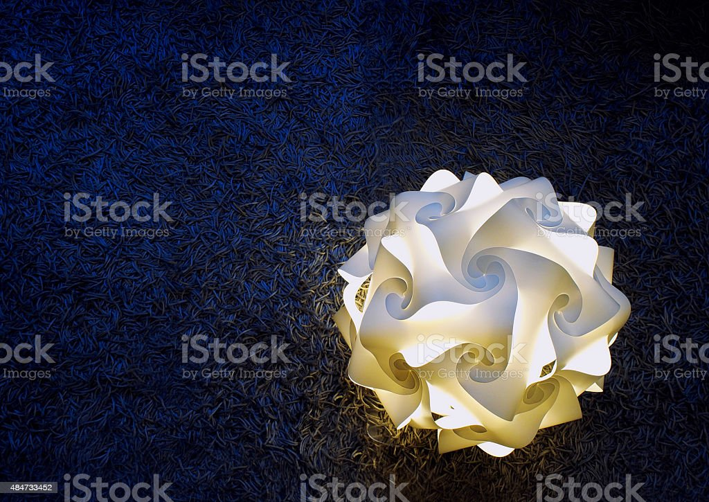 Lamp on blue carpet stock photo