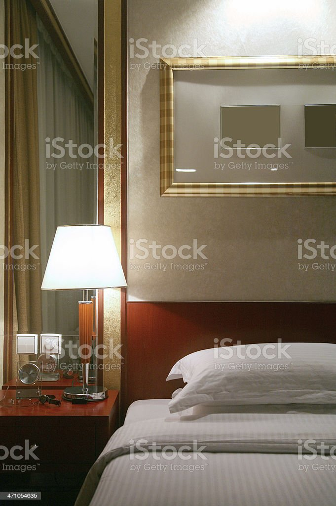 Lamp On Nightstand In Hotel Bedroom royalty-free stock photo