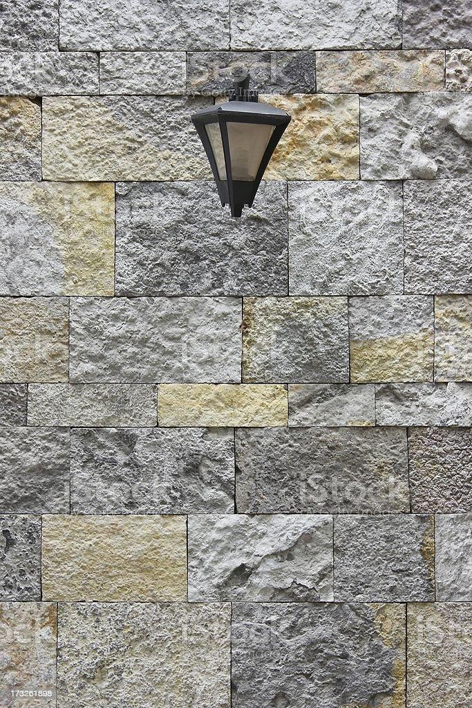 Lamp on Stone Wall royalty-free stock photo