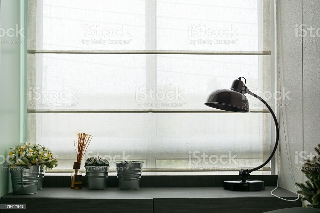 black lamp on wooden desk