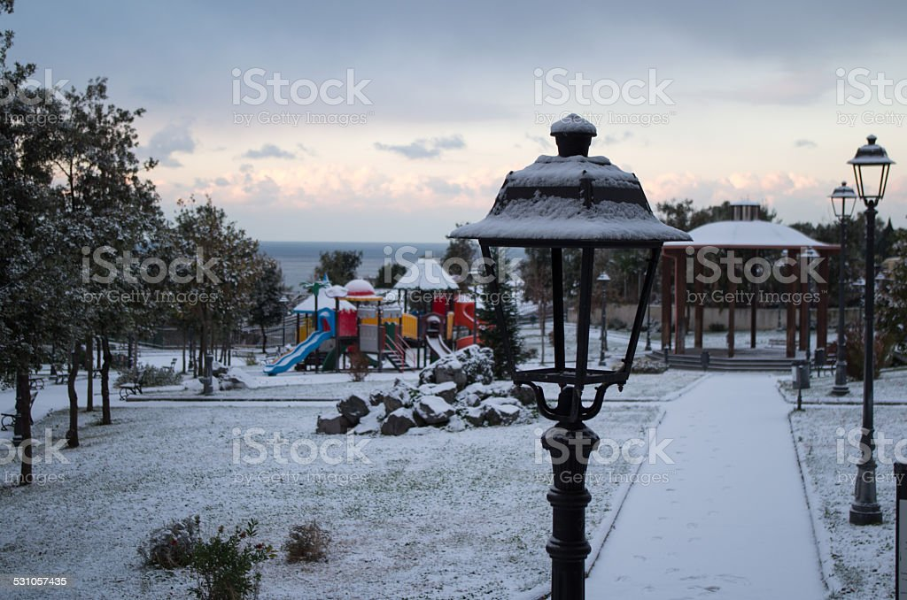 Lamp park with snow in Torre del Greco stock photo