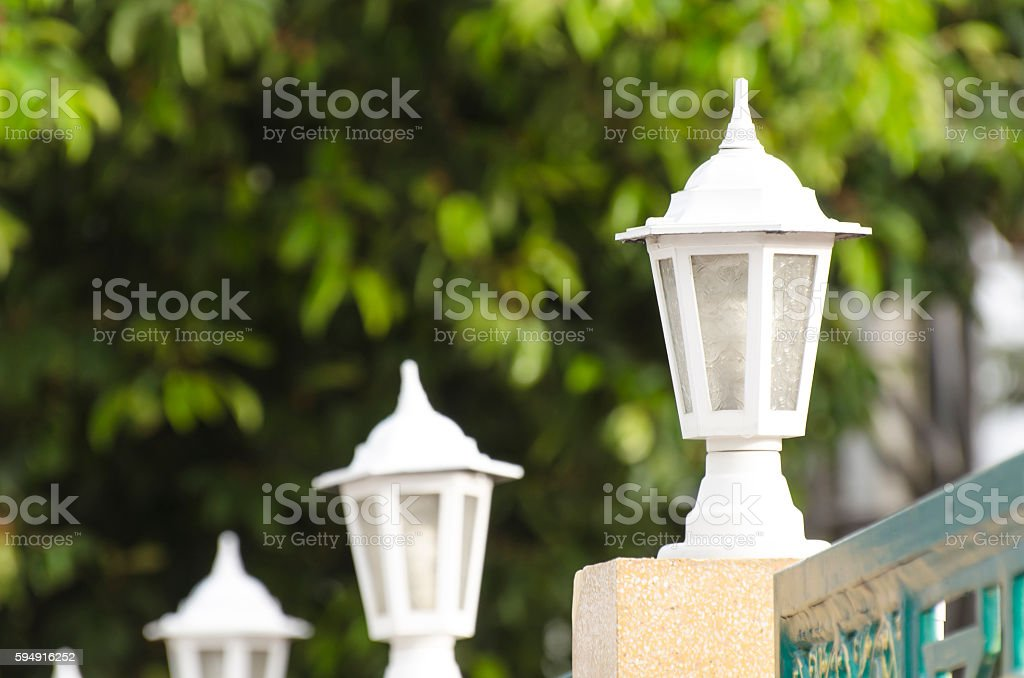 Lamp Pole and Fence stock photo
