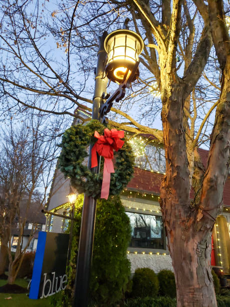 Lamp post decorated for Christmas stock photo